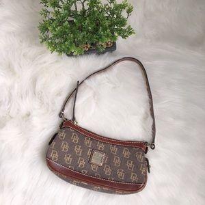 Dooney & Bourke mini top zip bag.